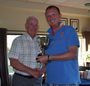 Chris Metcalf receives the McDowell Cup from Billy Boyd for 'best placed club member'.