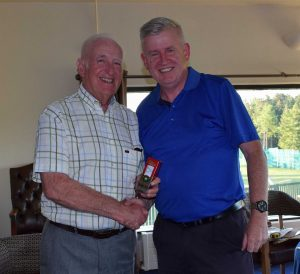 Kevin McConville is presented with his 'nearest the pin' prize from Billy Boyd