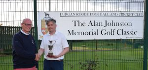 Overall winner Greg Crawford is presented with the Alan Johnston Memorial Trophy by John Henry