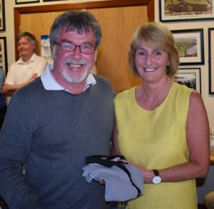 Ladies winner Fiona Cummins is presented with her prize by Jimmy Hamill
