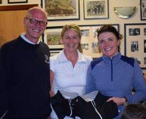 Members of the Ladies winning team, Sian Mulholland and Orla O'Dowd receive prizes from John Henry