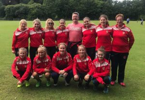 Lurgan Ladies Premier League winning team with coach Derek Heasley